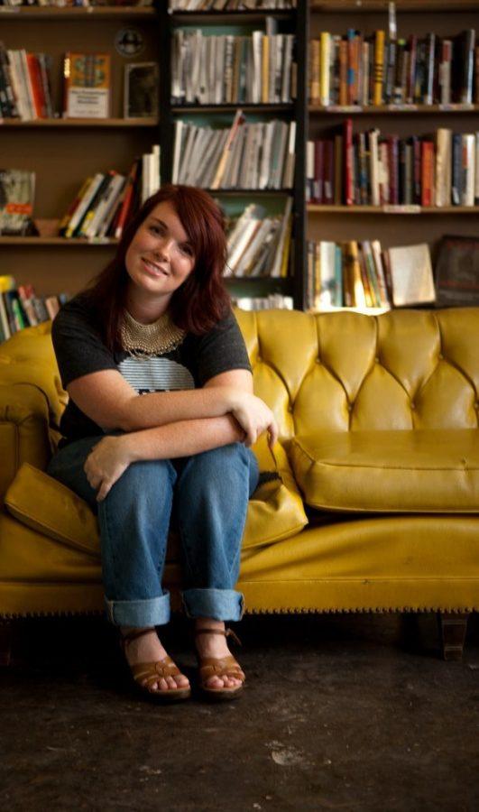 Poet+Lauren+Zuniga+poses+on+a+yellow+couch+for+Oklahoma+Magazine.%0APhoto+courtesy+of+Lauren+Zuniga.+