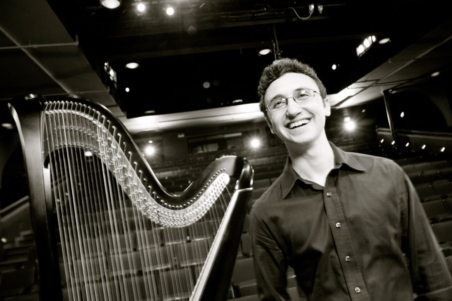 Harpist+Ben+Melsky+poses+with+his+harp%2C+the+instrument+he+has+played+since+he+was+eight.+He+will+be+performing+at+8+p.m.+in+Wallenberg+Hall+on+Saturday.%0APhoto+courtesy+of+Ben+Melsky.