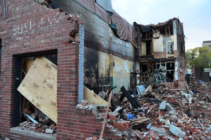 Photo by Ian Magnuson A vacant building that was once the Mississippi Café and a tattoo parlor were demolished after an early morning fire in Rock Island's Downtown District Sept. 27. A relief fund has been set up to help residents and business owners in the District.
