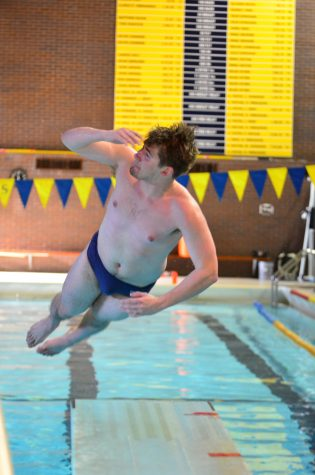 Josh Wielenga, senior, practices diving in the Carver pool. Photo by Ian  Magnuson.