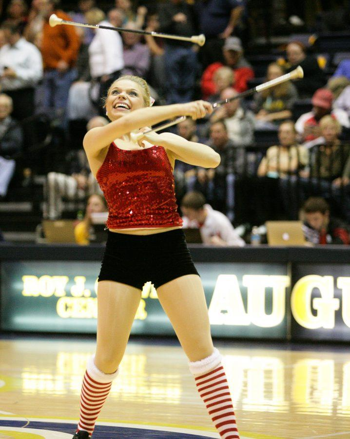 Baton+twirler+Lauren+Berquist+performs+in+the+Roy+J.+Carver+Center+on+Dec.+10+during+the+basketball+game.+Berquist%2C+a+first-year%2C+has+been+twirling+for+13+years+and+has+competed+at+the+national+level.%0APhoto+by+Hoang+Nguyen.