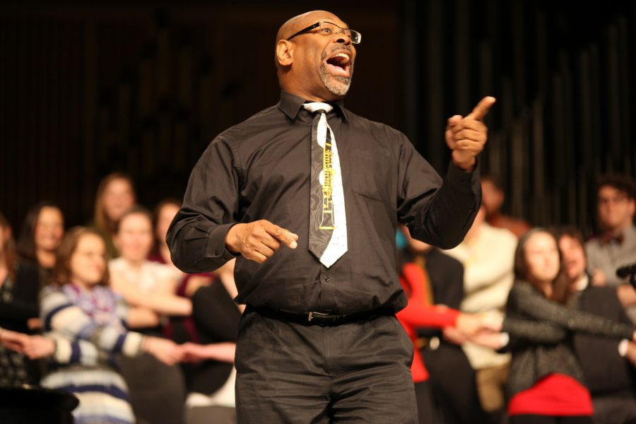 Keith+Hampton%2C+founder+and+artistic+director+of+the+Chicago+Community+Chorus+leads+the+audience+in+song+along+with+the+Augustana+Choir.