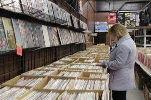 Augustana junior Catherine Cross shops for vinyl records at Ragged Records, a small record shop in Davenport. Ragged Records carries a variety of new and old vinyl, along with other music related items.  Photo by Linnea Ritchie.