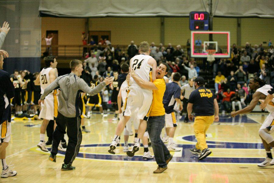 Junior+Griffin+Pils+jumps+into+the+arms+of+fellow+student+Frankie+Kalble+while+celebrating+seconds+after+the+game+ended.+Photo+by+Hoang+Nguyen.