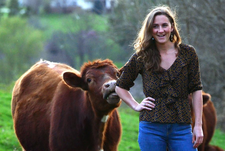 Below%3A+Senior+Samantha+Kammerman+watches+over+the+cows+on+her+family+farm+in+Milan%2C+Ill.+Kammerman+is+currently+training+for+the+Miss+Illinois+pageant.+If+she+wins+she+will+take+a+year+off+to+prepare+for+Miss+America.%0AAbove%3A+Kammerman+with+one+of+the+20+cows+her+family+raises.+Kammerman+hopes+to+expand+the+cattle+operation+to+60+cows+in+the+future.+Kammerman+cites+working+on+a+farm+as+a+lesson+in+strength+and+independence.%0APhoto+by+Ian+Magnuson.