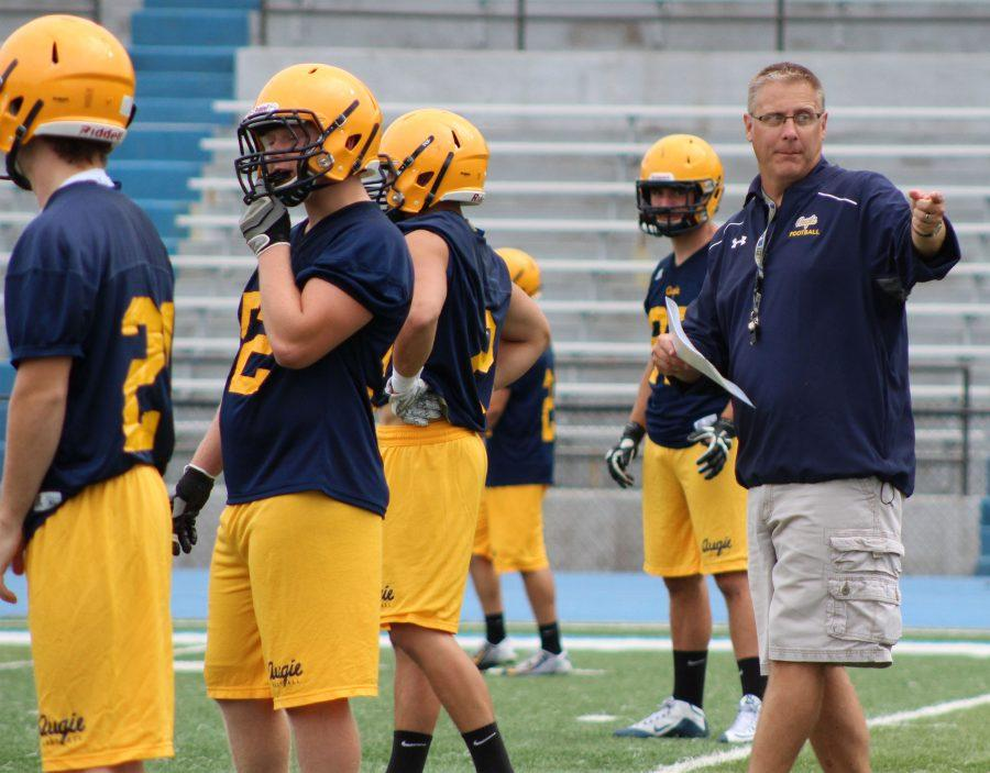 Head+coach+Bell+leads+a+Vikings+football+practice+before+their+first+game+Sat.+against+the+Mount+St.+Jospeph+Lions.