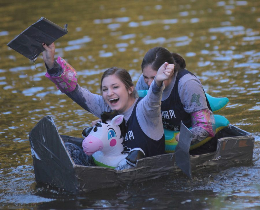 Students+participate+in+the+cardboard+regatta+races+in+the+Augustana+Slough.+Photo+by+LuAnna+Gerdemann.