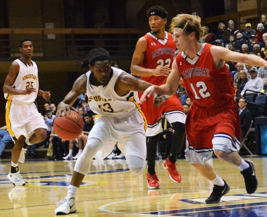 Senior+Jawan+Straughter+dribbles+the+ball+during+Augustanas+game+against+.+Photo+by+Ryan+Jenkins.+