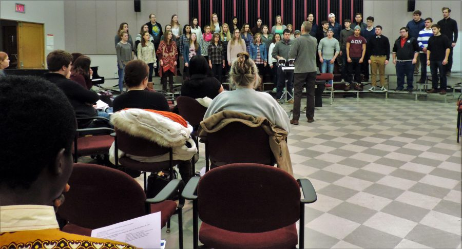 Attentive+audience+members+listen+to+a+song+preformed+by+the+Augustana+Choir+during+their+Symposium+Day+event+in+Bergendoff.
