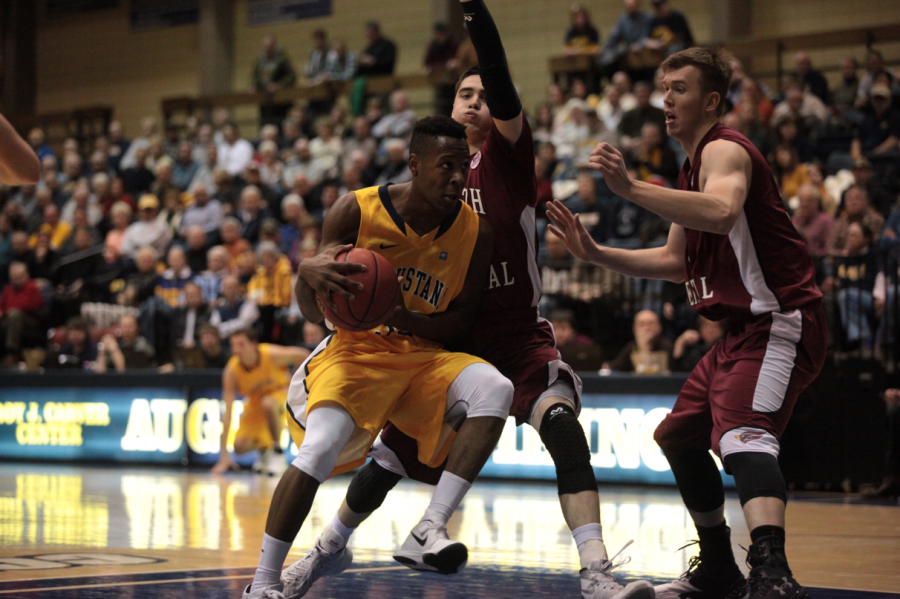 First-year+Chrishawn+Orange+drives+the+ball+against+North+Central+on+Jan.+13+in+the+Carver+Center.%0APhoto+by+LuAnna+Gerdemann.+