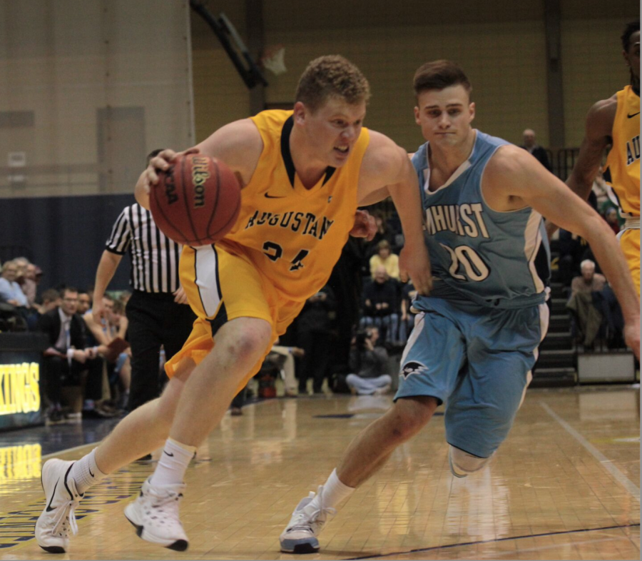 Senior+Griffin+Pils+drives+the+ball+against+Elmhurst+on+Wednesday+Jan.+28+at+the+Carver+Center.+Photo+by%3A+Jessica+Van+Roeyen.