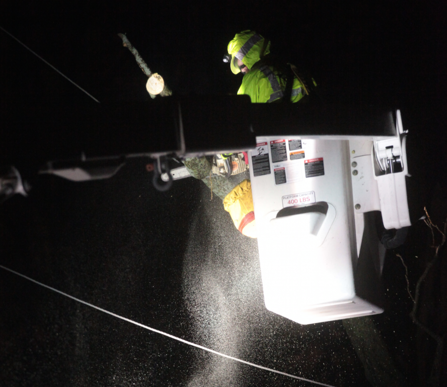 A+worker+in+a+cherry+picker+saws+a+tree+off+a+powerline+during+Tuesday+nights+power+outage.%0APhoto+by+Shylee+Garrett.+