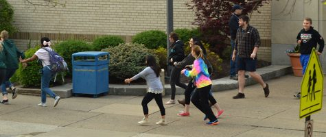 Participants flee from Centennial Hall during the active shooter drill on April 26.
