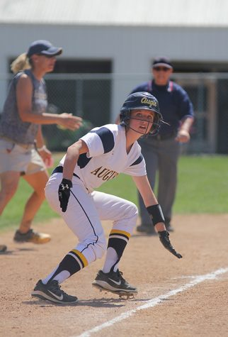 Augie Softball player plays against Millikin. Photo by Janie Le.