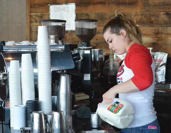 Augustana junior Haylee Walker prepares a signature latte at Miltown Coffee during her shift on Apr. 5, 2016. Photo by: Ryan Jenkins