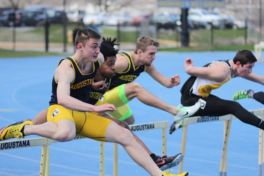 Tyler+Rubarts+%28left%29%2C+Matthew+Henry+%28middle%29%2C+and+Clayton+Sommers+%28right%29+run+the+110+meter+hurdle+race.+Photo+by+Janie+Le.+