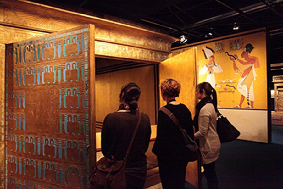 Vistors view open shrine at the King Tut exhibit at the Putnam Museum.