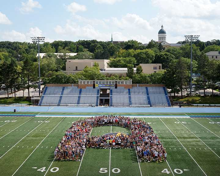 The+class+of+2020+forms+the+signature+Augie+A+on+the+football+field+during+the+2016+Welcome+Week.+%28Photo+provided+by+Augustana+College+Office+of+Communications%29