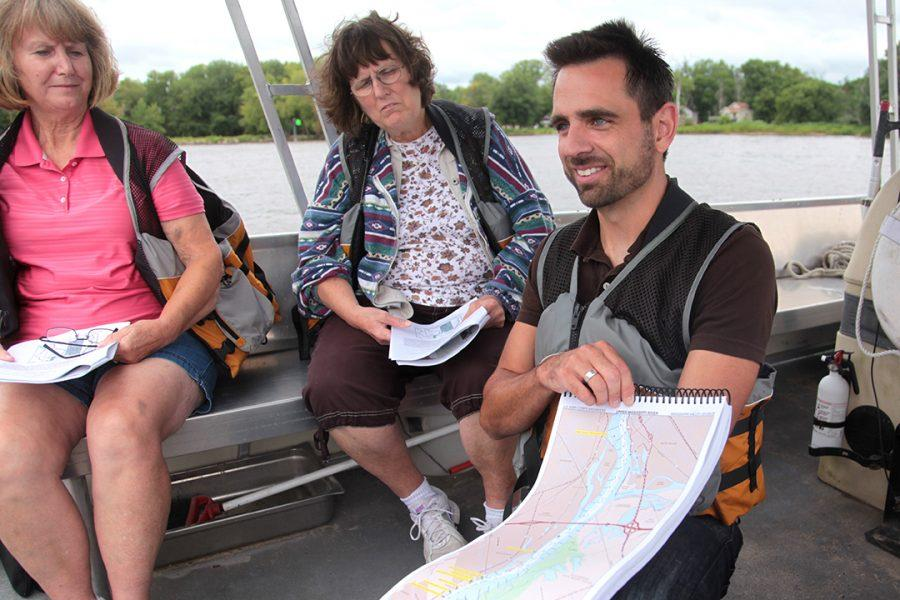 Dr.+Heine+locates+and+identifies+various+parts+of+the+Mississippi+River+on+a+map.+Photo+by+LuAnna+Gerdemann.