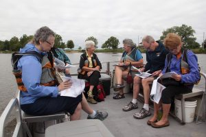 There were 11 people who participated in Dr. Heine's Riverine Walk boat educational tour.