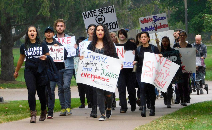 Students%2C+faculty+and+community+members+march+around+the+lower+quad+in+response+to+the+administration+and+its+policy+on+diversity+and+inclusivity+on+campus.+The+protest+was+sparked+by+the+controversial+chalking+written+on+the+lower+quad+in+mid-September.+Photo+by+Marlen+Gomez