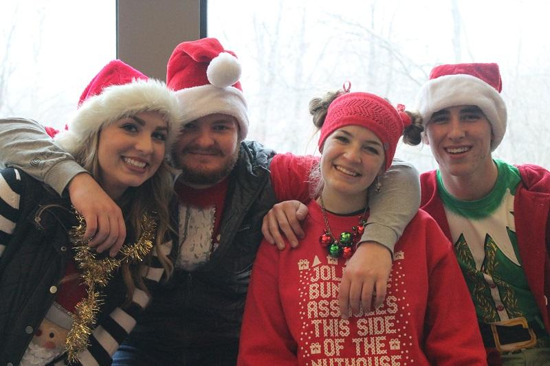 Jamie+Thulin%2C+Jack+Kotowski%2C+Hanna+Pegarsch%2C+and+Jordan+Ford+celebrate+Christmas+Extrav%0A