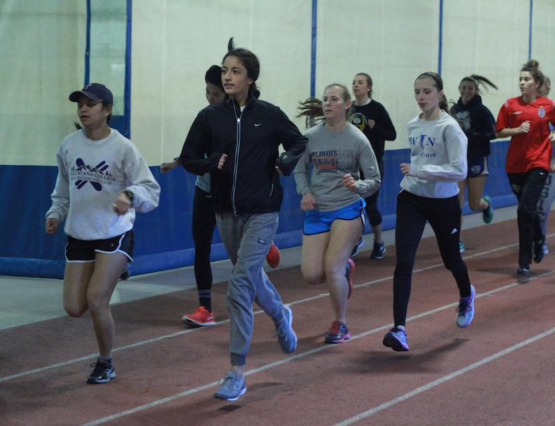 Womens+Track+run+during+one+of+their+practices.+Photo+by+Tawanda.+