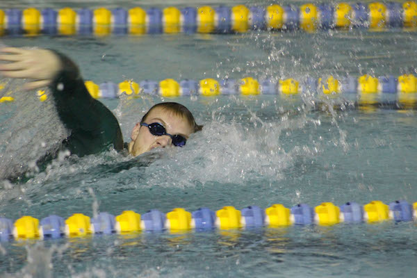Sophomore Bryan Haage swims at last weeks practice. His relay would set the meet record in the 400 free relay at Grinnell the week before. Photo by Kevin Donovan.