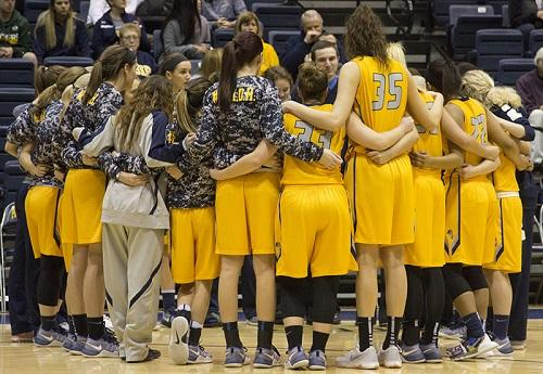 Augie Basketball Team cheer each other up before the game begins. Photo by Janie Le.
