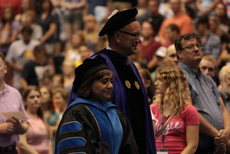 President Steven Bahls and Provost Pareena Lawrence head towards the stage in Carver during the 2015 Welcome Week Opening Convocation. Photo courtesy of Observer photo files.
