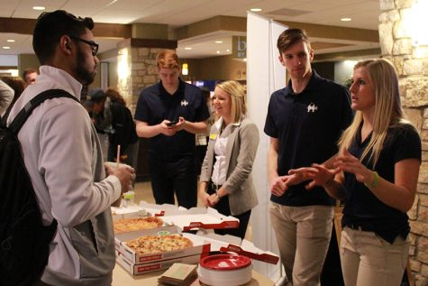Allan Daly and Courtney Kampert speak with Kumail Hussain at the SGA Meet and Greet. Photo by Lu Gerdemann.