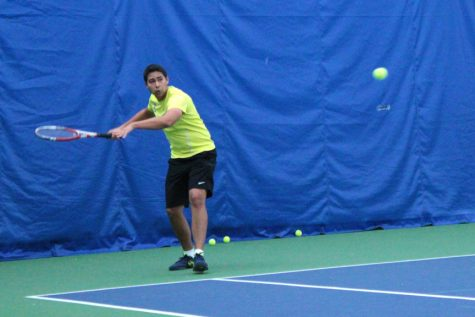 Senior Nick Prabhakar practices at the Moline Tennis Club. The Vikings will play against Elmhurst and Knox College this Saturday. Photo by Lu Gerdemann.