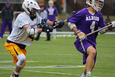 Sophomore Jason Van Dyck defends Albion senior Zach Ubbell during their game on Saturday, March 25. Vikings fell to Albion 5-13. Photo by Alia McMurray.