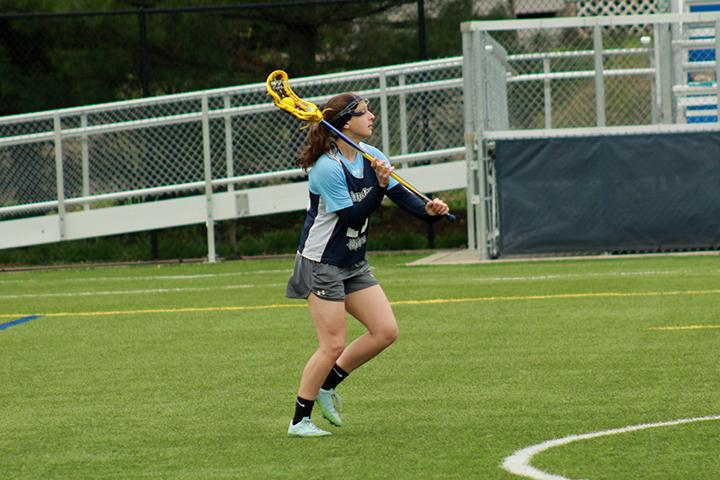 Olivia+Mayer+works+on+passing+drills+at+practice.+Mayer+won+two+CCIW+Offensive+Player+of+the+Week+awards.+Photo+by+Lu+Gerdemann.
