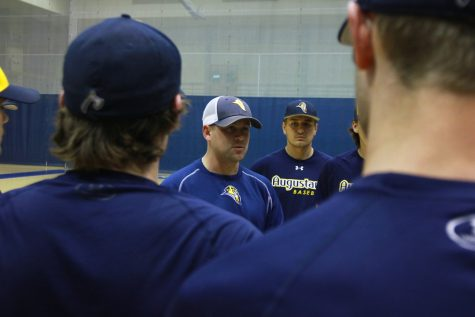 Pitching coach Justin Hauer meets with Augustana baseball players during practice. The Vikings will play two CCIW opponents this weekend.