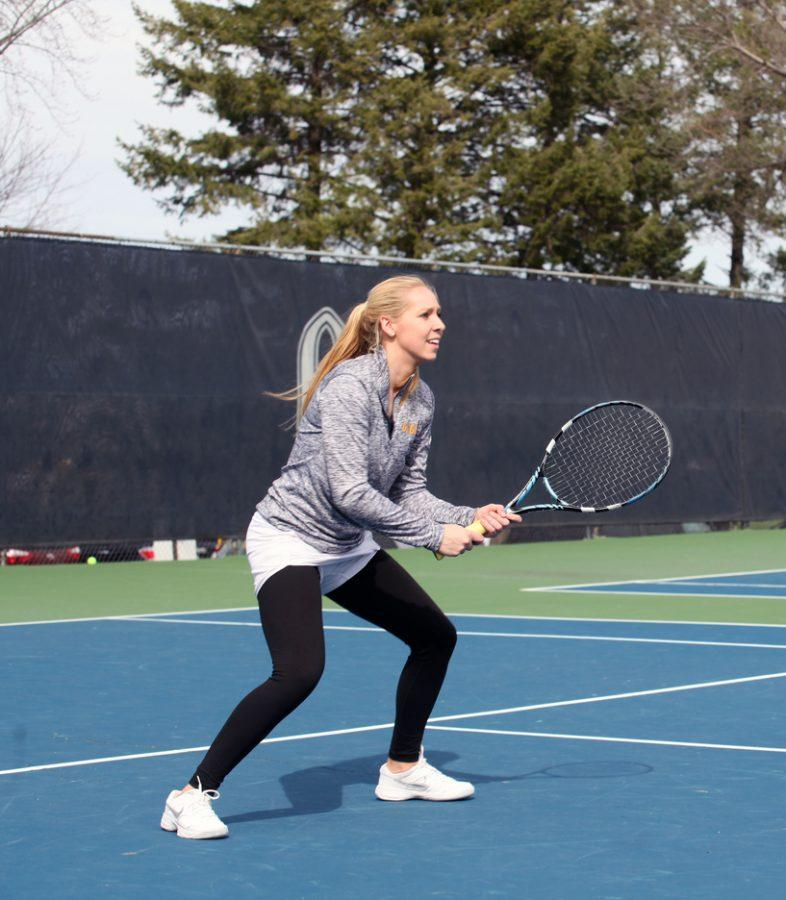 Senior+Lauren+Goggin+watches+for+a+serve+from+her+sister%2C+Dana%2C+before+Saturdays+home+tennis+match.+Photo+by+Alex+Halterman.