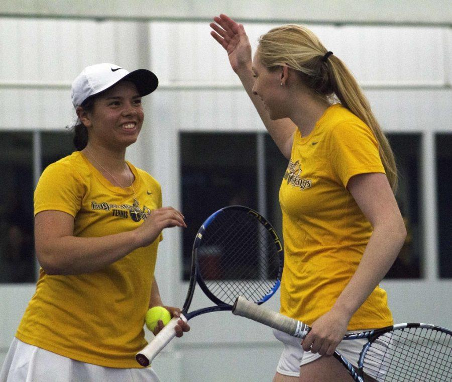 Sophomore+Madeline+Lombardi+and+Senior+Lauren+Goggin+%28left+to+right%29+congratulate+each+other+after+a+match+during+the+AQ+Tournament+last+Saturday.+Photo+by+Kevin+Donovan.
