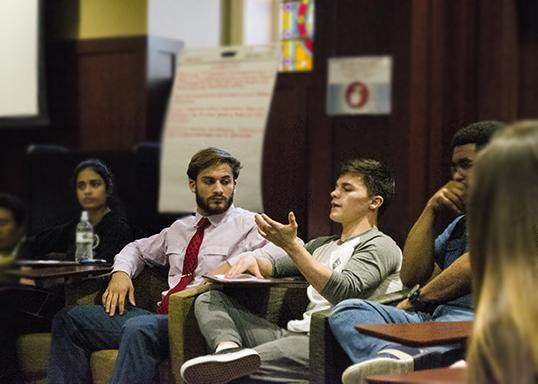 Senior Davis Baxter speaks out at the Internationial Student Life open forum for the Charlottsville Attack. Photo by Corynn Hajdys