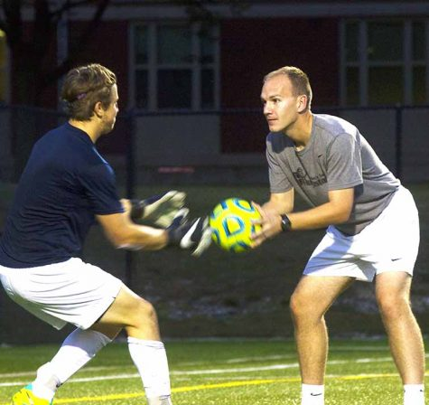 Assistant mens soccer coach Joe Sagar runs his goalkeepers through warm up drills to help them prepare for the upcoming game. Photo by Jordyn Strange