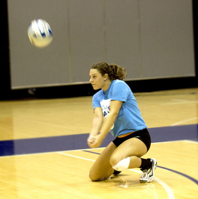 Freshman+Morgan+Anderberg+delivers+a+pass+to+the+setter+during+womens+volleyball+practice.