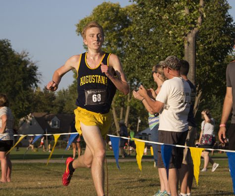 Junior Brandon Wilkerson sprints the final leg of his race on Friday. Photo by Kevin Donovan