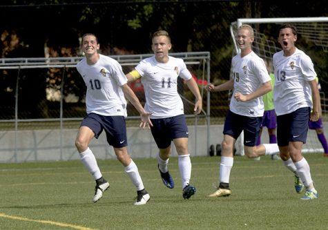 (From left) Matthew Allen, Grant Bracken, Chris Plantz and Daniel Artman celebrate Allens goal against Knox College on September 16th.