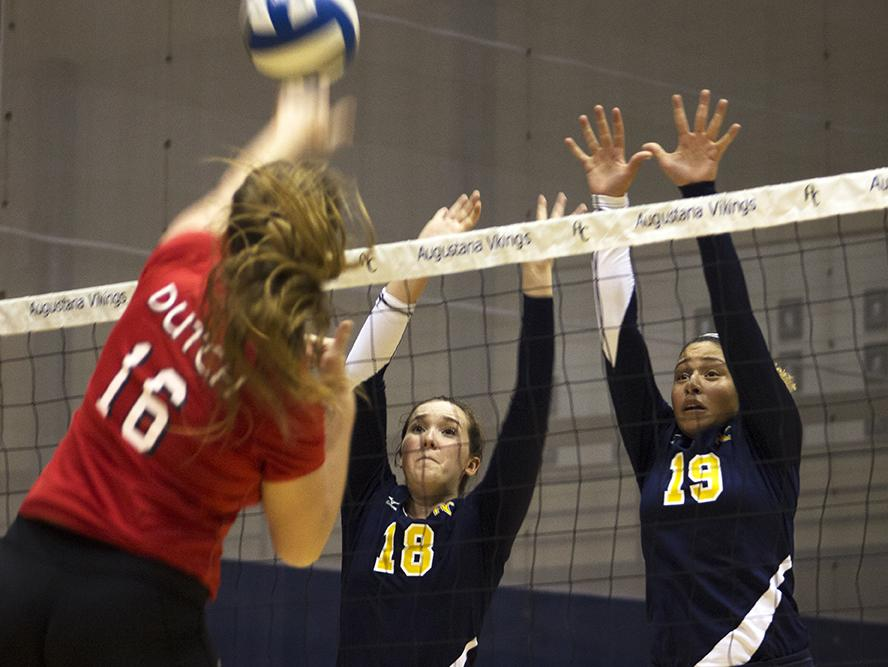 Taylor Steger (20) and Kaylah Townsell (21) jump to block a spike from Central last Friday. Photo by Kevin Donovan