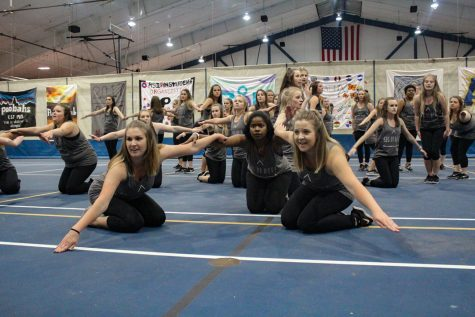 Members of the Sigma Pi Delta sorority perform their yell routine. Photo by Lu Gerdemann.