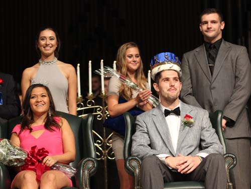 Gabby Gambino and Adam Gronewold crown Erin Ansusinha as Vi-Queen and senior Jake Sppechley as Vi-King at Augustanas 2017 Coronation and Sing competition. Photo by Maria Do.