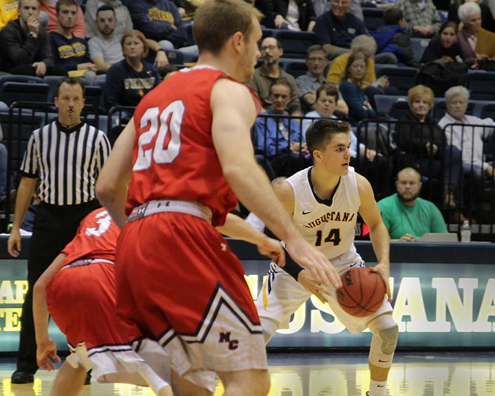 Junior+Nolan+Ebel+prepares+to+pass+the+ball+during+the++men%E2%80%99s+basketball+game+against+MacMurray+College.+Photo+by+Tony+Dzik.