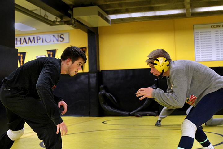 Senior+Brendan+Gould+and+freshman+Josh+Diehl+train+together+at+their+wrestling+practice.+Photo+by+Tony+Dzik.