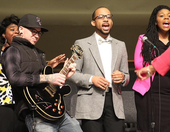 Jason Hartley plays the guitar while Jareen Hardin leads the Community Choir at the 2018 Community Celebration and Musical Tribute to Honor Dr. Martin Luther King Jr. Photo by Maria Do.
