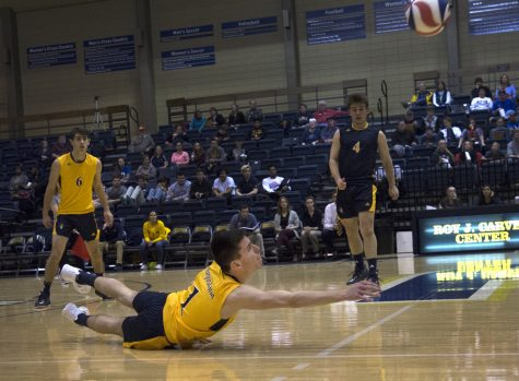 Augustana freshman Richard Baum (#1) dives to make a save during the Vikings match against Judson on Saturday. The match was the first ever in Augustana mens volleyball history. Photo by Kevin Donovan