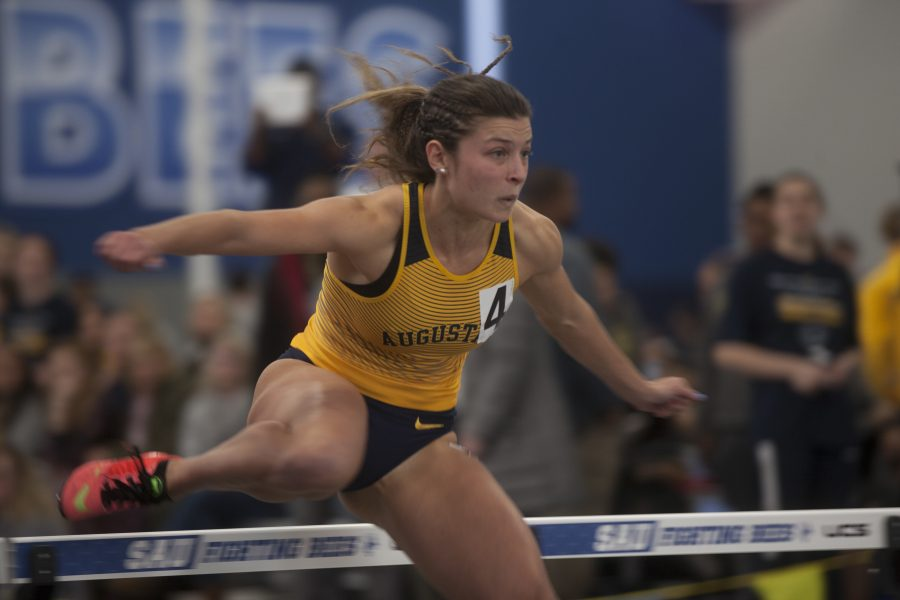 Sophomore+Sofia+Wajner+clears+the+last+hurdle+during+her+race+at+St.+Ambrose+on+Saturday.+Photo+by+Kevin+Donovan
